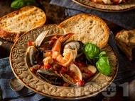 Яхния от морски дарове – бяла риба, миди и скариди с домати и червено вино